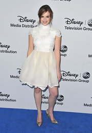 Elizabeth Henstridge rocked a white and cream dress with an embellished turtleneck blouse and a full tulle skirt.