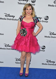 Kirsten Vangsness chose a hot pink ruffled dress with a panther detail and plaid shoulder piece for her look at the Disney Media Upfront in Burbank.