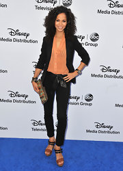 Sherri paired this black blazer over an orange button down for a cool color-blocked look.