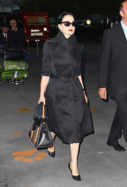 Dita Von Teese accentuated her waist in a tightly belted black trenchcoat.