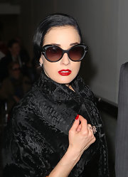 Dita Von Teese arrived in Melbourne with her signature red lipstick and nails perfectly in tact.