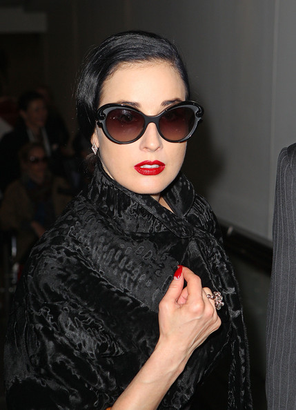 0befb7057489 Dita Von Teese s Ruby Red Lipstick at the Melbourne International Airport