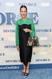 Cynthia Rowley attended the New York premiere of 'Divorce' wearing a black and green midi dress.