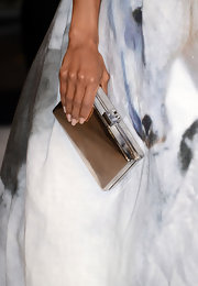 Kerry Washington could check her makeup in the mirror finish on her silver box clutch.
