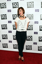 "Allison sports a quirky ""oui"" t-shirt to the Power of Youth Celebration.  This black and white outfit is charming with her ribbon bow-tie choker."