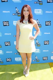Jillian Rose Reed kept it fun and flirty with a pale yellow frock that featured sheer cap sleeves a pointed collar and a brooch embellishment at the collar.