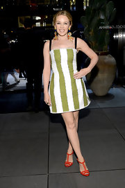 Kylie's green-and-white striped mini dress gave her a fun and whimsical look at the Dolce & Gabbana 5th Avenue store opening.