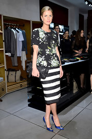 Nicky mixed patterns when she paired this black-and-white striped pencil skirt with a floral blouse.