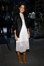 A classic leather jacket gave Leandra Medine a cool rocker look at the opening of the Dolce & Gabbana store at 5th Avenue.