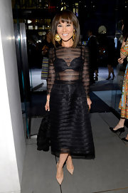 Alina Cho showed just a touch of skin with this sheer LBD.