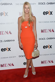 Beth Ostrosky-Stern sported a vibrant tangerine strapless dress at the 'Madonna: The MDNA Tour' premiere.