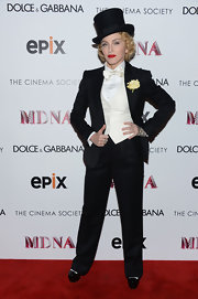 Madonna sported a classic three-piece tuxedo and top hat at the premiere of her 'Madonna: The MDNA Tour' in NYC.