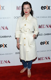 Debi stepped out in a crisp white raincoat with nude buttons.