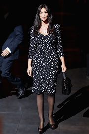 Monica paired her print dress with black peep-toe pumps.