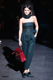 Miroslava Duma kept it conservative down below in a pair of high-waisted navy slacks.
