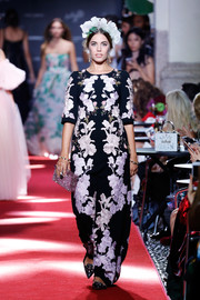Amber Le Bon was classic in a floral-embroidered gown while walking the Dolce & Gabbana runway.