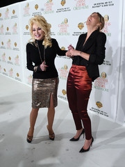 Dolly Parton paired her top with a metallic leopard-print pencil skirt.
