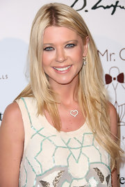 Tara Reid attended the Domingo Zapata Oscar Art Show wearing her lightened tresses in long layers.