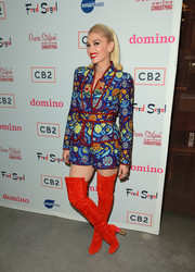 Gwen Stefani added an extra pop of color with a pair of red thigh-high boots, also by Schiaparelli Couture.