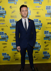 Joseph Gordon-Levitt opted for a deep blue suit with spotted tie for his red carpet look at SXSW.