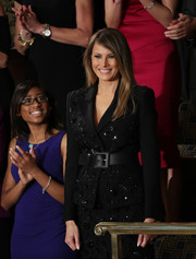 Melania Trump added some shape to her suit with an oversized black belt.
