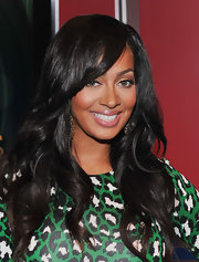 La La Anthony visited the set of 'FOX and Friends' wearing long, sexy layers with loose waves with side-swept bangs.