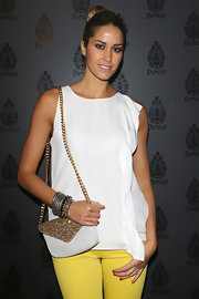 A classic gold chain strap bag added some sparkle to Elena Santarelli's look at Donup Fashion event in Milan.