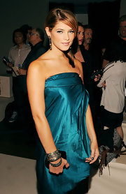 Actress Ashley Greene attended the Donna Karan Collection Spring 2011 Fashion Show during Mercedes-Benz Fashion Week wearing a set of oxidized sterling silver and rose cut diamond cuffs.