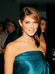Actress Ashley Greene attended the Donna Karan Collection Spring 2011 Fashion Show during Mercedes-Benz Fashion Week wearing oxidized sterling silver and pave diamond three tier Tahitian pearl drop earrings.