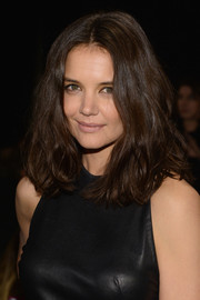 Katie Holmes went for edgy styling with this tousled, wavy 'do during the DKNY 30th anniversary fashion show.