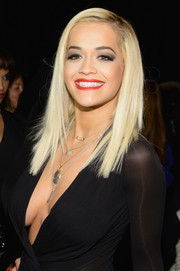 Rita Ora attended the DKNY 30th anniversary fashion show wearing her hair in edgy straight layers.