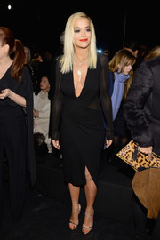 Rita Ora absolutely sizzled at the DKNY 30th anniversary fashion show in a tight-fitting sheer-panel LBD with a belly-grazing neckline.