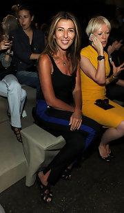 A pair of black strappy sandals added some flair to Nina Garcia's simple outfit at the Donna Karan Spring 2012 fashion show.