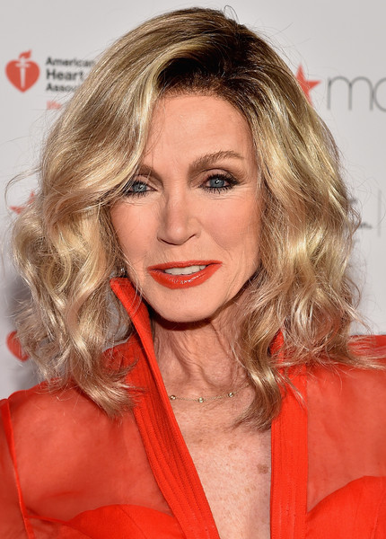 Donna Mills Medium Wavy Cut [hair,blond,face,hairstyle,lip,chin,eyebrow,beauty,layered hair,long hair,go red for women red dress collection 2015,donna mills,lincoln center,new york city,american heart association go red for women red dress collection,macys,red carpet,mercedes-benz fashion week,fashion show]