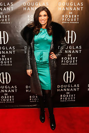 Kimberly Guilfoyle added a touch of Old Hollywood glamour to her ensemble at the Douglas Hannant fragrance launch with a metallic evening coat featuring a fur collar.
