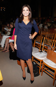 Kimberly Guilfoyle looked chic and classic in a navy wrap dress at the Douglas Hannant fashion show.