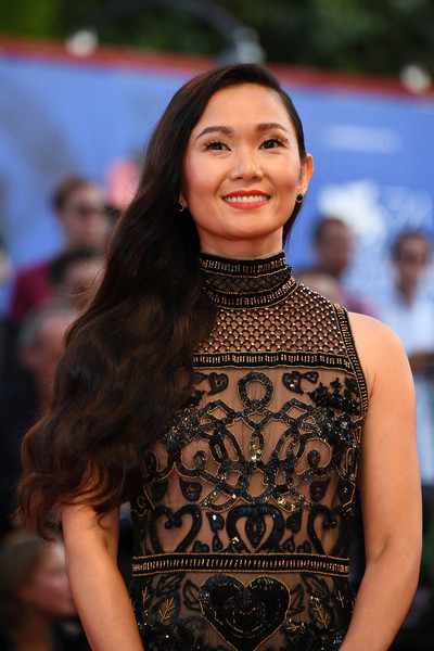 Hong Chau wore her long hair down in a side-swept wavy style at the Venice Film Festival opening ceremony.