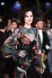 Michelle Dockery teamed Bulgari statement rings with her Valentino gown for total glamour at the Rome Film Fest screening of 'Downton Abbey.'