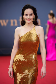 Michelle Dockery matched her shimmering gown with a gold bangle for the world premiere of 'Downton Abbey.'