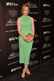Melissa George had us green with envy when she sported this light green drape-neck dress.