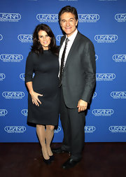 Lisa Oz looked great with her wavy shoulder length hairstyle at Dr. Oz's Health and Happiness Summit in New York City.
