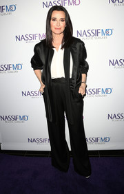 Kyle Richards was masculine-chic in this black suit and white shirt combo at the grand opening of Dr. Paul Nassif's new medical spa.
