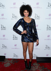 Dejah Brown teamed her tiny dress with black ankle boots.