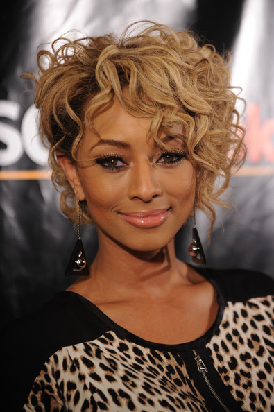 Keri Hilson showed off her dangling earrings while attending the So Kodak Campaign.