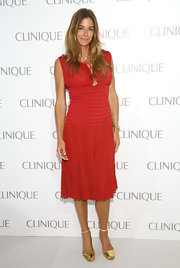 Kelly Bensimon chose a ruby red dress with a fitted waist and flowing skirt while out at the Clinique Dramatically Different Party in NYC.