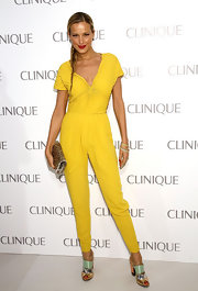 Petra sported a fitted sunshine yellow jumpsuit with a rouched bodice to the Dramatically Different Party sponsored by Clinique.