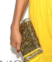 Petra's golden sequined clutch complemented her yellow jumpsuit.