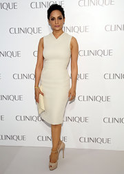 Archie Panjabi wore a laser-cut sleeveless off-white sheath dress to the Dramatically Different party in NYC.