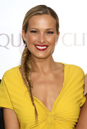 Petra's golden locks looked sleek as ever when braided into a stunning fishtail braid.