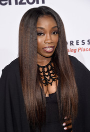 Estelle attended the Dress for Success 20th anniversary gala wearing ultra-long, flat-ironed tresses.